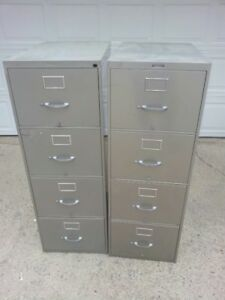 A Pair of 4-Drawer Vertical Filing Cabinets