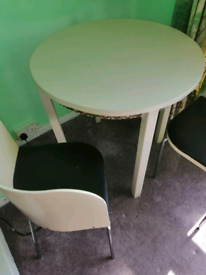 FREE hand made round table with two curved chairs.