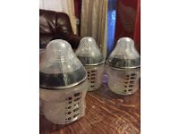 Brand new packed Tommee Tippee bottles set £10