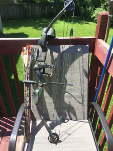 Compound bow with carbon arrows and trigger release.