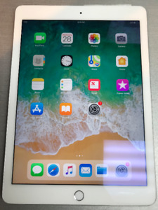 iPad Air 2 WIFI SLIVER W/ STORE WARRANTY