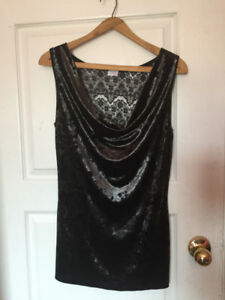 Women's sleeveless shimmery top with upper back lace.