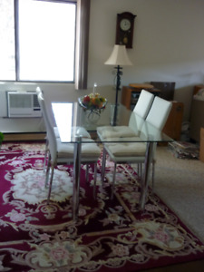 Glass Top Dining Table And $ Chairs