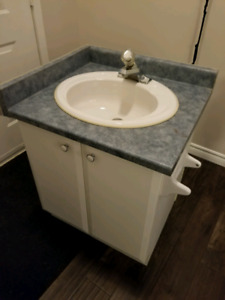 Vanity complete with sink and faucet