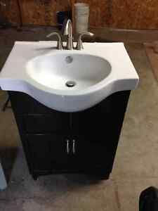 Vanity with sink and faucets