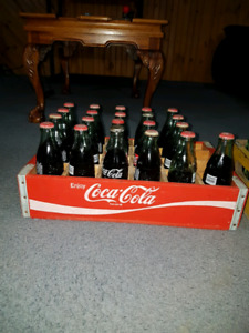 Antique coke cola crate and bottles