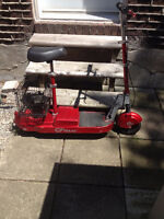 REDUCED!!  two wheel scooter with battery charger and basket