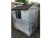 Garden shed with new roll of roof felt