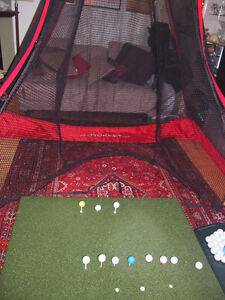 Virtually new Real Feel golf mat with tray with Rukknet, etc.
