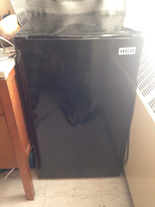 Mini fridge, black, good condition, looking for a kind home