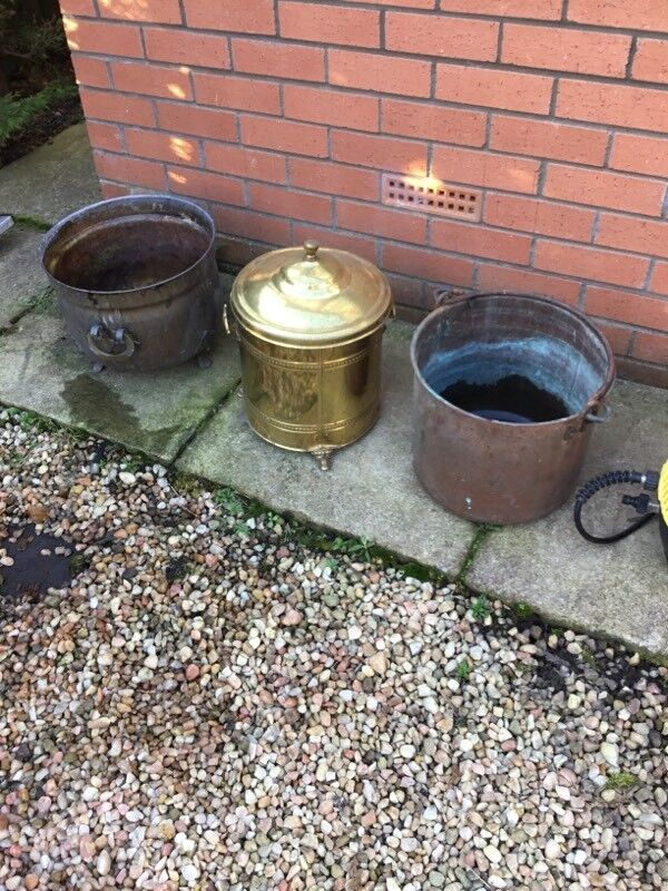 Copper and brass plant pots etc