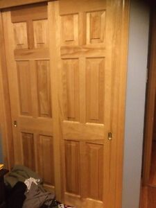 Two solid pine sliding closet doors
