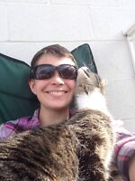 Young Lady and her cat looking for a home