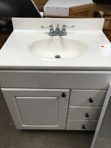 Small White Vanity with Faucet