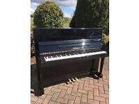 Black shiny modern upright piano by Nieer Belfast pianos