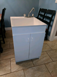 Laundry Sink & Moen faucet wit 2 door cabinet / selling as a set