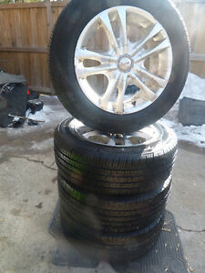 4 215/60R16 All Season tire mounted on alloy Universal rims