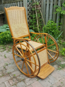 Antique late 1800's or early 1900 oak and wicker wheel chair