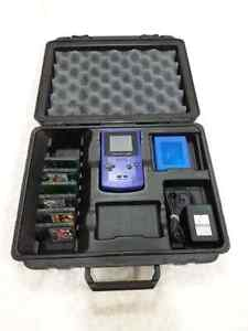 Rare GBC hard carrying case with console and games.