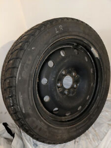 4 Winter Tires on Steel Rims Studded. 205/55R16. Used.
