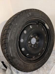 4 Winter Tires on Steel Rims Studded. 205/55R16. Used.
