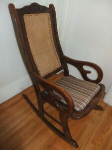 solid wood bowmanville cane back rocking chair in exc condition