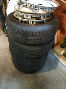 Selling 175/65 R14 newer winter tires on rims with hubcaps
