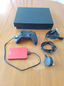 Xbox one x with controller and 500gb hard drive