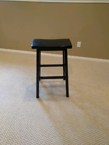 Black wooden saddle seat stool - Airdrie