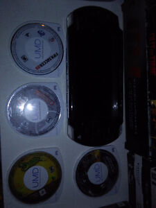 PSP slim with 5 games like new!