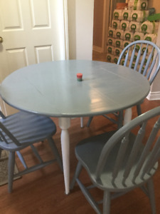 delivery included- newly refinished solid wood dining table 3 ch