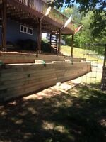 Landscaping, retaining walls, cement work, fences