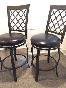 Two metal swivel bar stools With seat pad