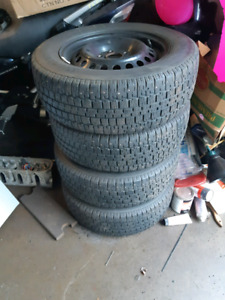 """15"""" 5×108 steel wheels with ford TPMS and winters"""