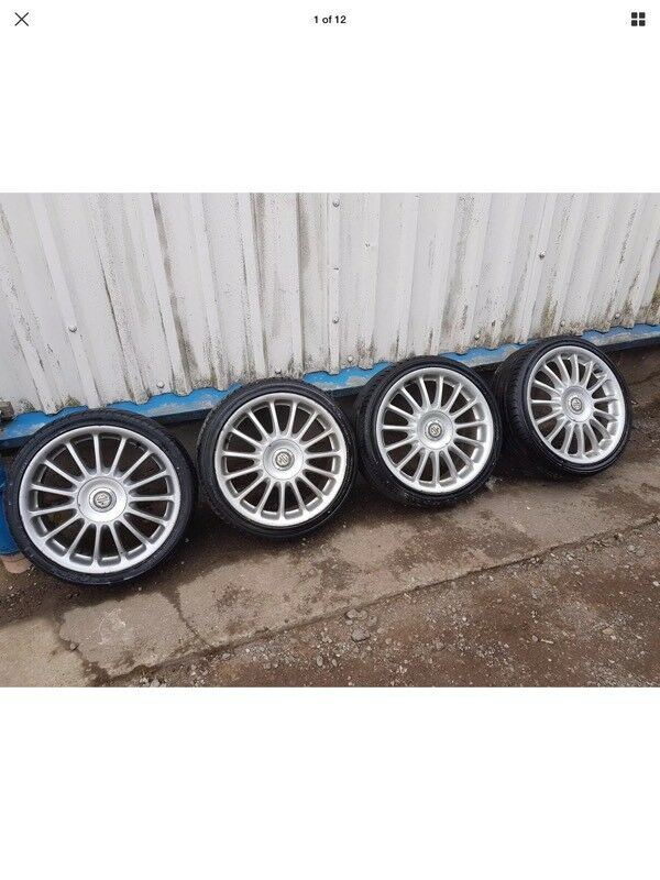 MG ROVER ALLOY WHEELS,17 INCH MULTISPOKE WITH TYRES AND CAPS