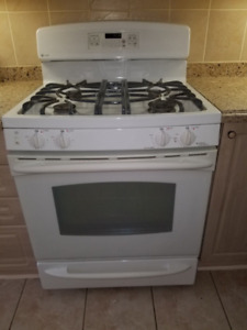 GE GAS STOVE WHITE, KITCHEN AID FRIDGE, DISHWASHER.