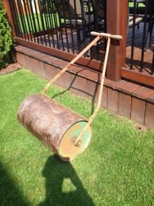 24 inch lawn roller. Filled with sand.
