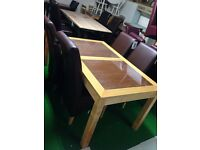 Brown glass table £99 chairs £50