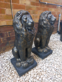 Large stone tall lion statues