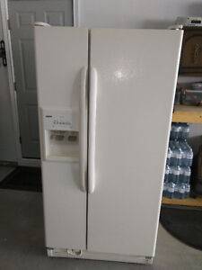 Kenmore cream coloured side by side Refrigerator