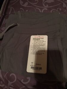 BNWT unlined dance studio 2 pants Size 4 and light grey in color