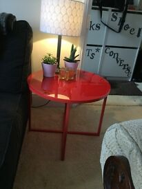 Two John Lewis red side tables.