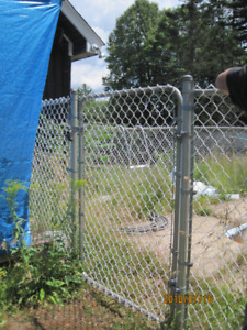 150 Ft chain link fencing with locked gate