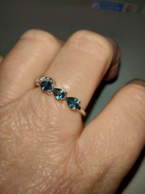 White gold ring sapphires and diamonds