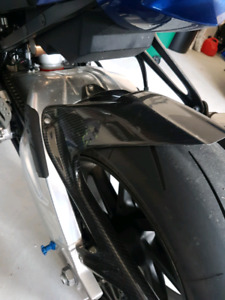 BMW S1000RR carbon fibre one piece rear hugger and chain guard
