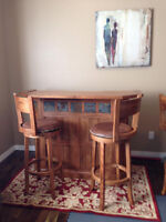 Solid wood bar and table and stools. Like new