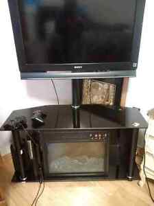 Glass tv stand with electric fireplace