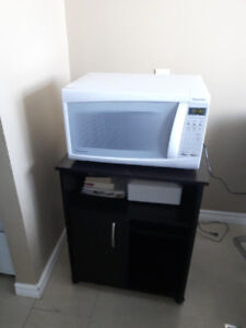 Microwave and small table stan