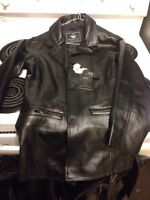 His and hers black faux-leather coats