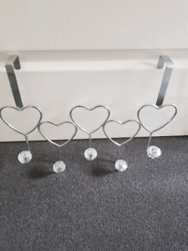 Heart shaped over the door hooks in excellent condition.